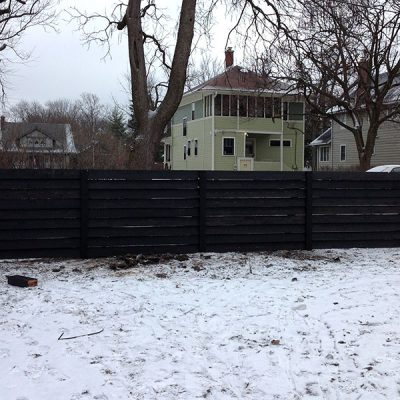 A photo of the custom fence for the Chavez family's new home installed by First Fence