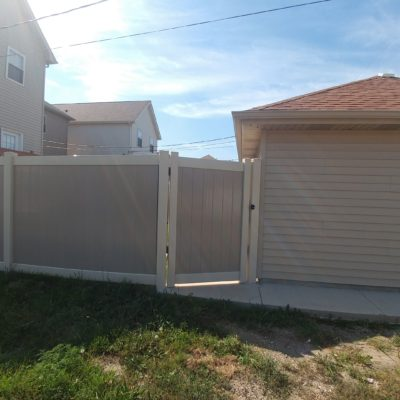 Photo of an offset vinyl PVC gate and fence designed and installed by First Fence