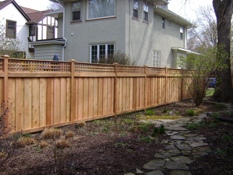 Photo of a traditional fence with a lattice topper designed and installed by First Fence Company