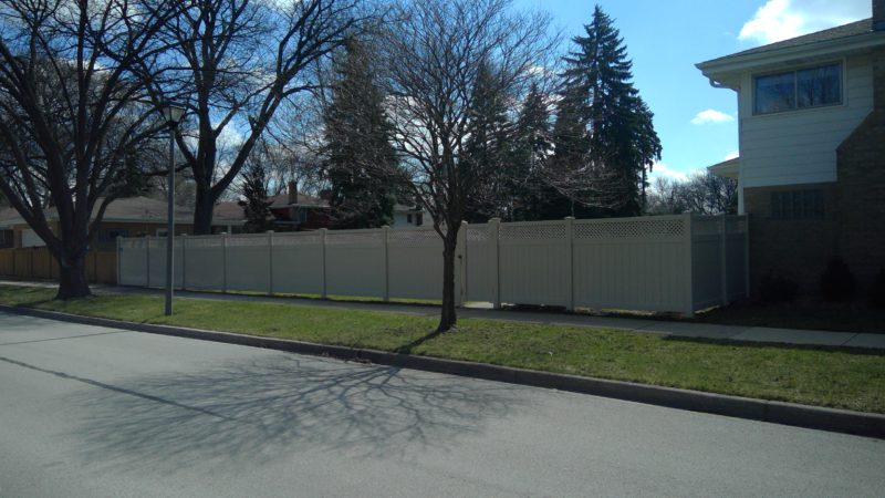 Photo of a tan sand ottawa PVC vinyl fence designed and installed by First Fence