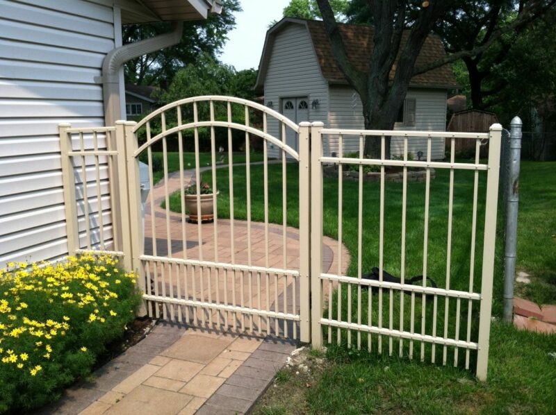 Photo of an aluminum arched walk gate designed and installed by First Fence