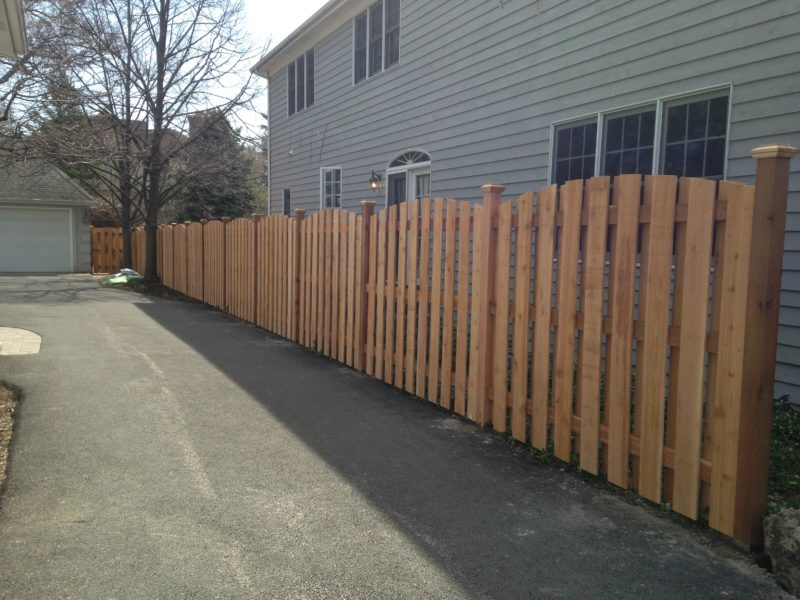 Photo of a custom board on board arched fence designed and installed by First Fence Company