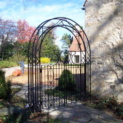 Photo of a custom powder coated iron arbor and gate
