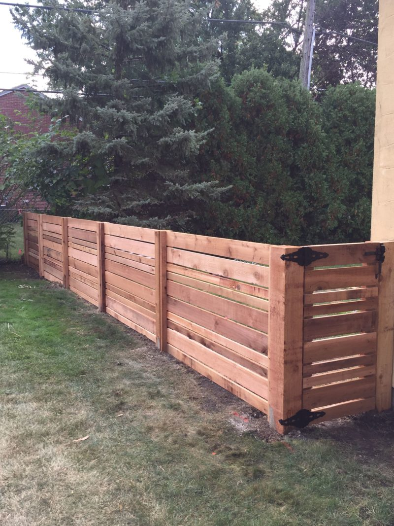 Photo of a custom horizontal wood fence installed by First Fence Company