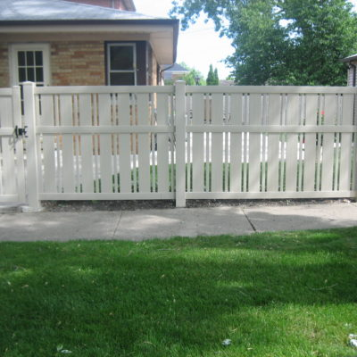 Photo of a White PVC Moline Sand style vinyl fence designed and installed by First Fence
