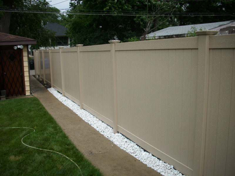 Photo of a tan Adobe Peru PVC/vinyl fence designed and installed by First Fence