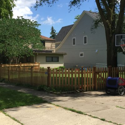 Photo of a picket wood fence installed by First Fence Company