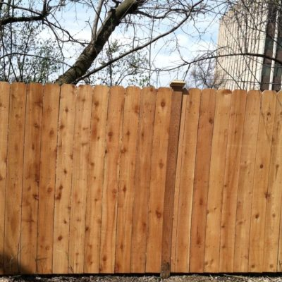 Photo of a solid board dog ear fence installed by First Fence Company