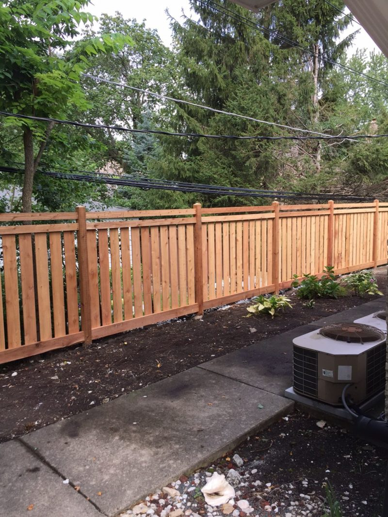 Photo of a spaced tradtional fence custom designed, built and installed by First Fence Company