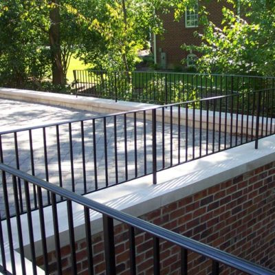 Photo of custom powder-coated iron railing atop a second story balcony