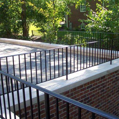 Photo of custom powder-coated iron railing atop a second story balcony
