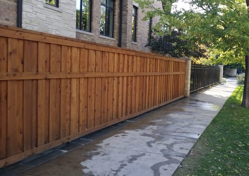 Wood Fence into Aluminum