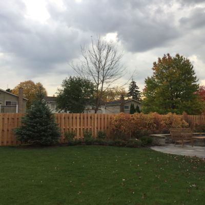 Photo of a shadowbox wood fence that follows the grade installed by First Fence Company