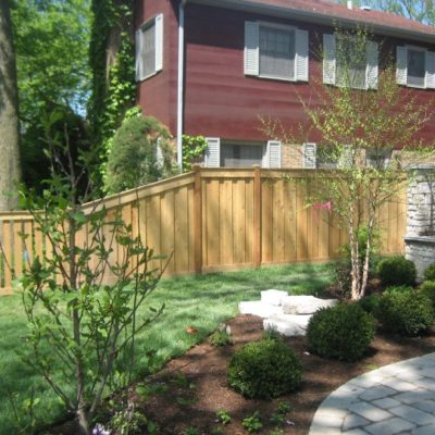 Board on Board wood fence with smaller transition installed by First Fence Company