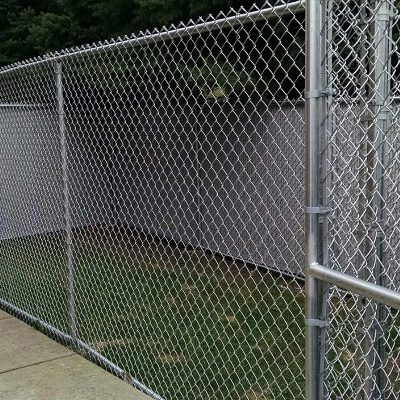 Photo of a custom chain link dog fence installed by First Fence Company in Hillside, IL