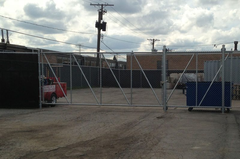 Photo of a custom commercial cantilever gate installed by First Fence