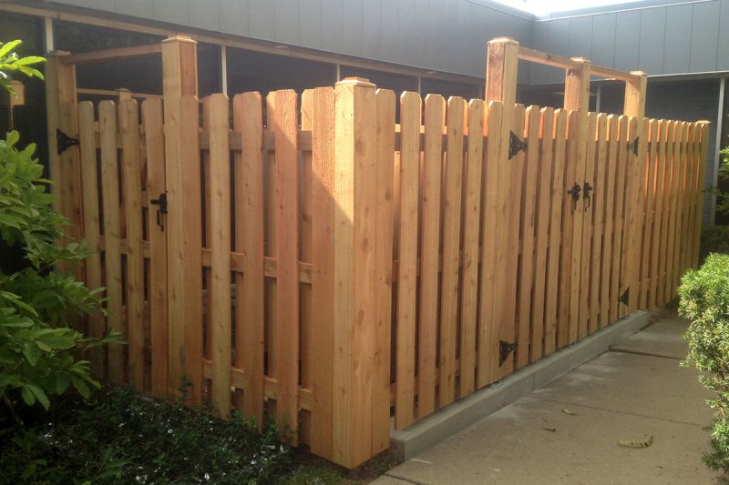 Photo of a custom courtyard enclosure fence installed by First Fence