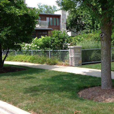 Photo of a custom residential masonry iron fence installed by First Fence