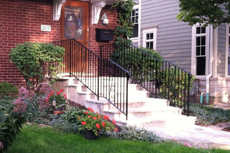Photo of a custom powder coated iron railing - First Fence