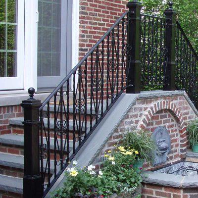 Photo of a custom powder coated iron railing - First Fence