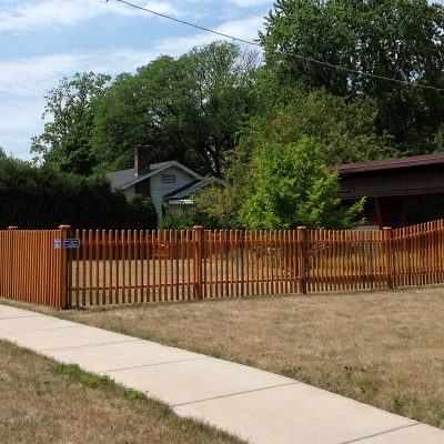 Photo of a custom ironwood fence installed by First Fence