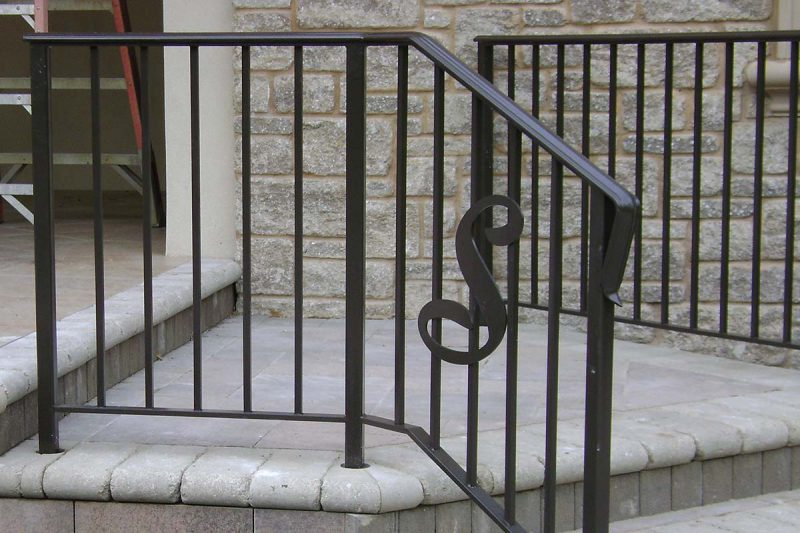 Photo of a custom laser cut logo railings - First Fence
