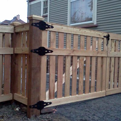 Photo of a custom wood gate installed by First Fence