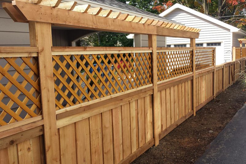 Photo of a custom wood pergola designed, built and installed by First Fence Company in Hillside, IL