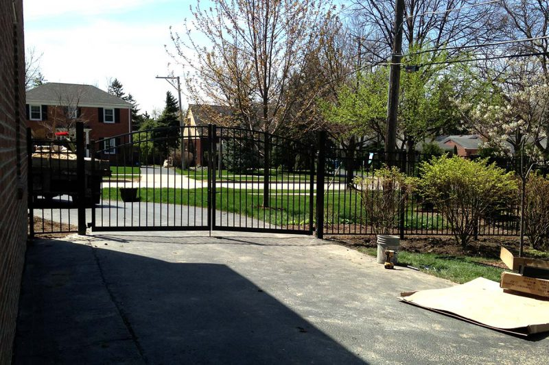 Photo of a custom follow the grade gate installed by First Fence