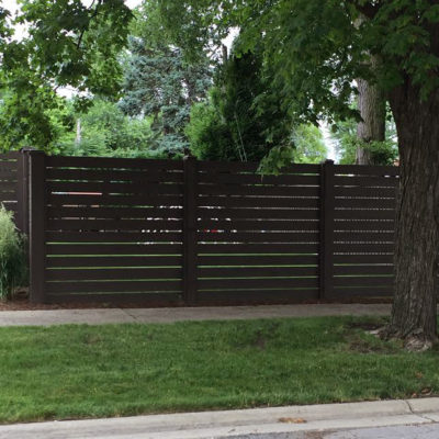 Photo of a custom horizontal stained wood fence installed by First Fence Company