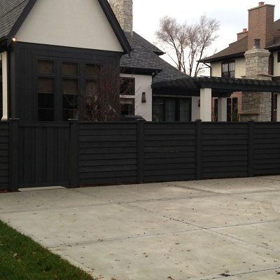 Photo of a custom horizontal pre-stained fence installed by First Fence