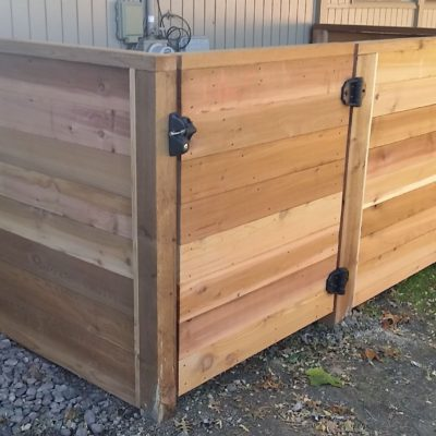 Photo of a custom horizontal stained wood HV/AC enclosure installed by First Fence Company