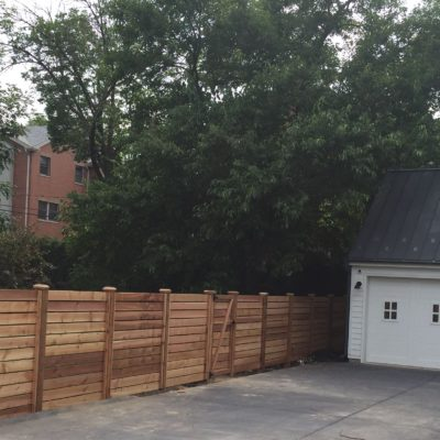 Photo of a custom horizontal wood fence at a modern farmhouse residence installed by First Fence Company