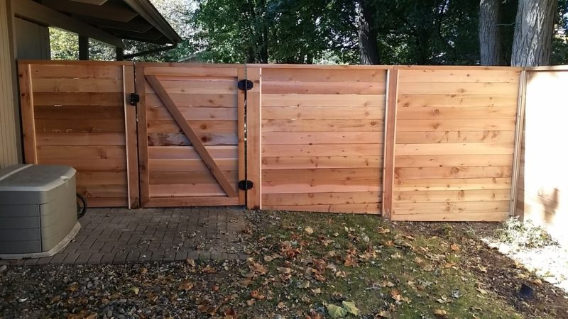 Photo of a custom horizontal wood fence and gate designed and installed by First Fence Company in Hillside, IL