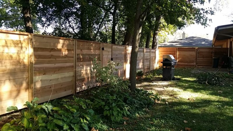 Photo of a custom horizontal wood fence designed and installed by First Fence Company in Hillside, IL