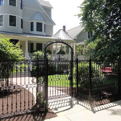 Photo of custom powder coated iron fence and gate- First Fence
