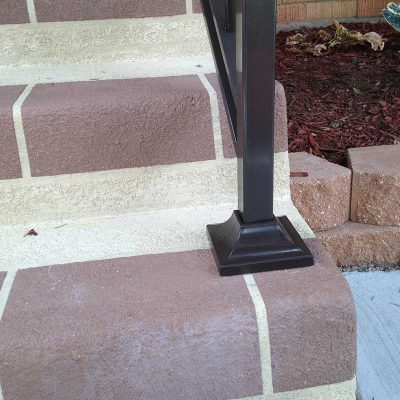 Photo of an iron railing footing - First Fence