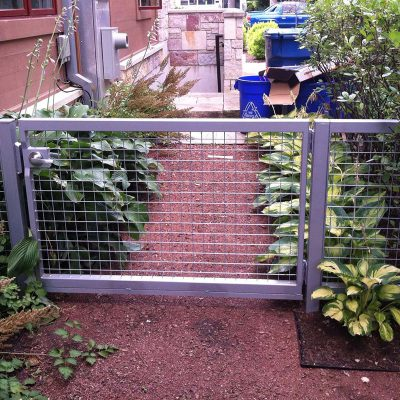 Photo of a custom iron framed gate - First Fence