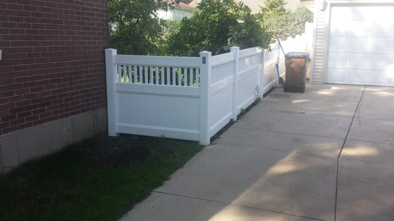 Photo of a 4 foot white Juniper vinyl/PVC fence designed and installed by First Fence