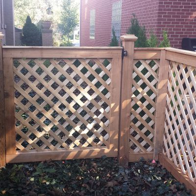 Photo of a custom designed lattice fence installed by First Fence