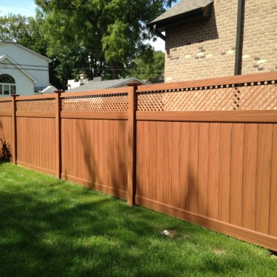Photo of a brown Mocha Ottawa PVC/vinyl fence designed and installed by First Fence