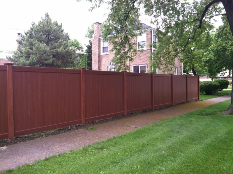 Photo of a Mocha Peru vinyl/PVC fence designed and installed by First Fence