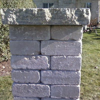 Photo of a stone pillar before First Fence Company installed a custom fence