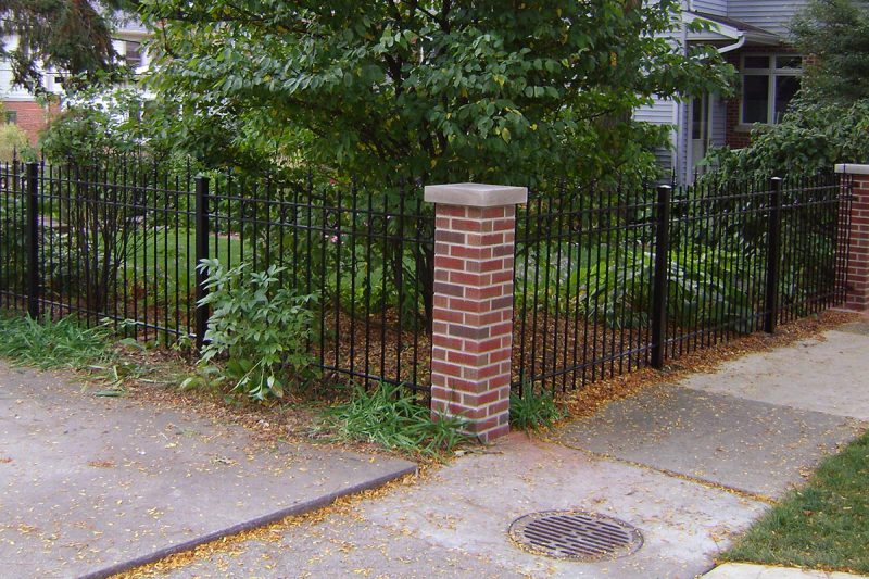 Photo of a custom pillar fence installed by First Fence Company