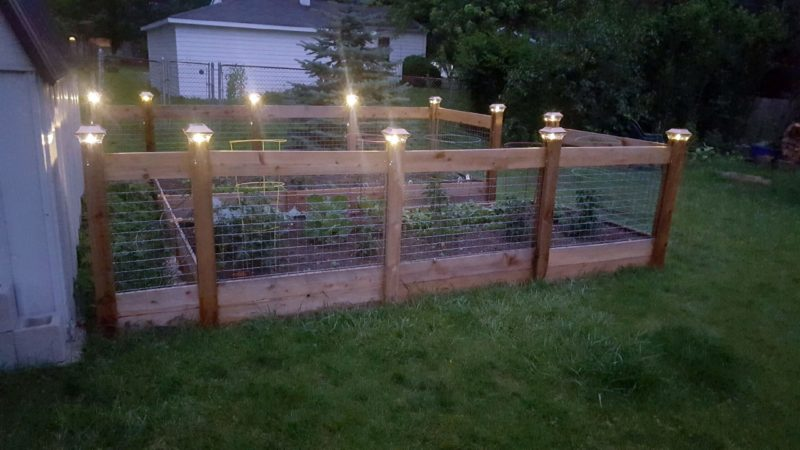 Raised garden custom designed and installed by First Fence Company