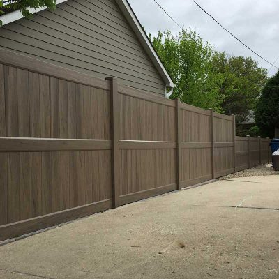 Photo of residential green teak vinyl pvc fence - First Fence