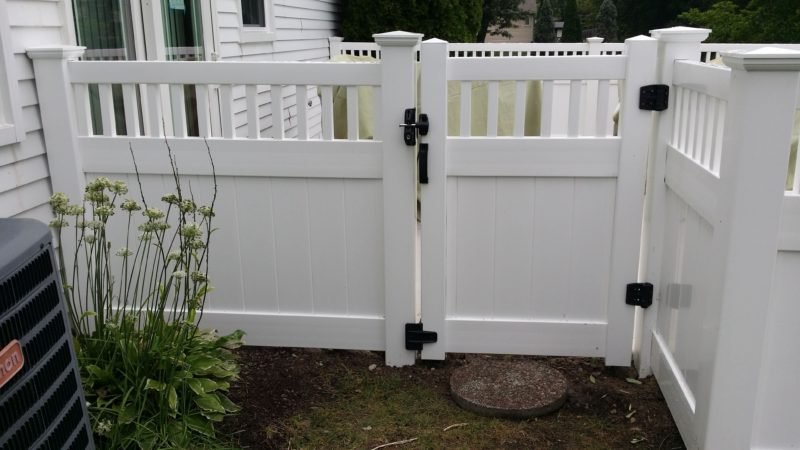 Photo of a semi-private vinyl gate installed by First Fence Company in Hillside, IL