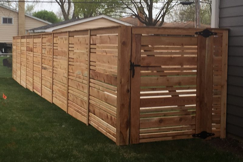 Photo of a custom wood fence installed by First Fence