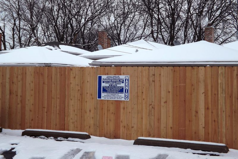 Photo of a custom commercial wood fence installed by First Fence Company in Hillside, IL