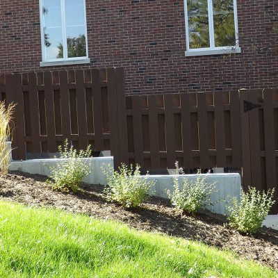 After photo of a custom Endwood fence installed by First Fence Company to enclose a refrigeration unit